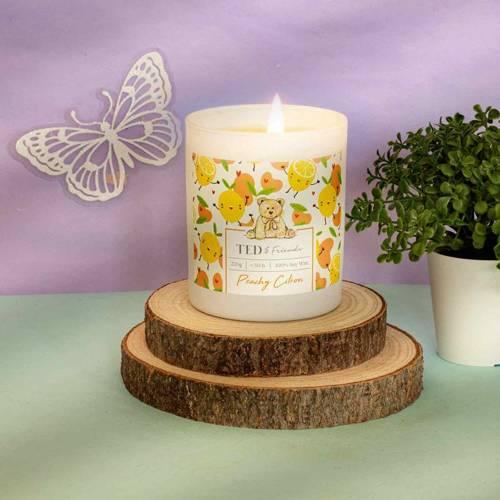 Ted & Friends sojowa świeca zapachowa w białym szkle 220 g - Peachy Citron